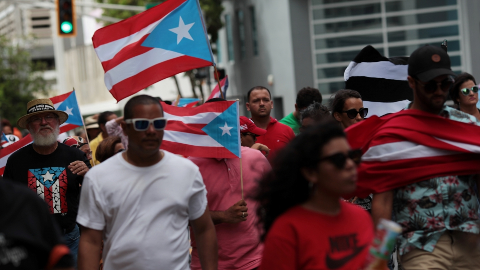 People march in support of Puerto Rico becoming an independent nation as the economically struggling U.S. island territory voted overwhelmingly on Sunday in favour of becoming the 51st state, in San Juan, Puerto Rico June 11, 2017.