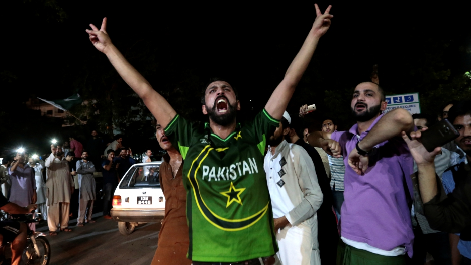 Pakistani cricket fans, in Islamabad, cheer after Pakistan defeated India in the Champions Trophy finals