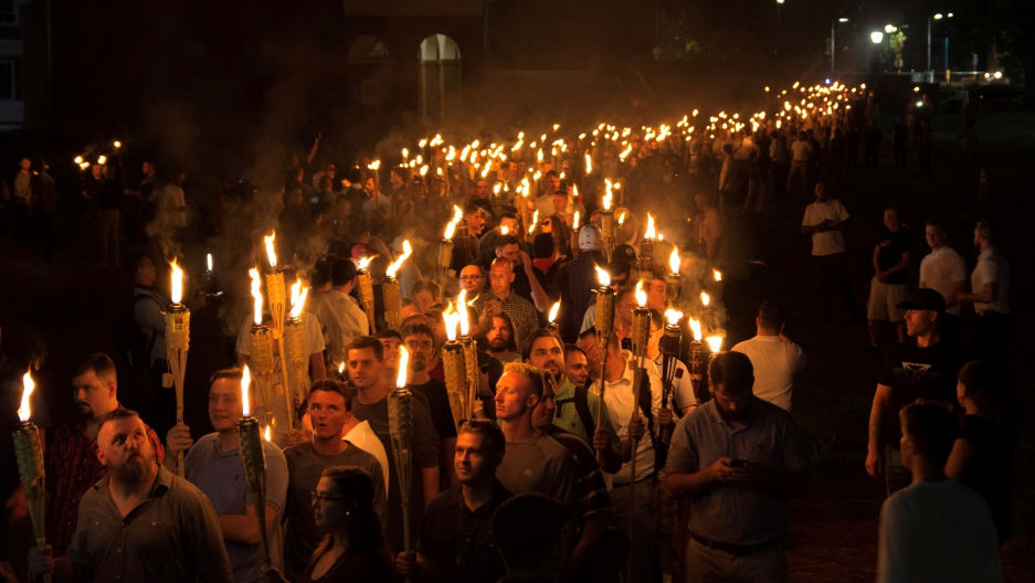 White nationalists carry torches on the grounds of the University of Virginia, on the eve of a planned Unite The Right rally in Charlottesville, Virginia, US August 11, 2017. Picture taken August 11, 2017.