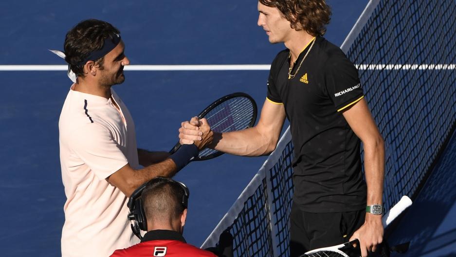 Roger Federer of Switzerland (left) shakes hands with Alexander Zverev of Germany.