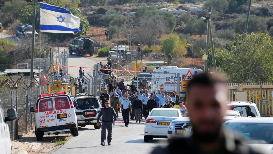 Israeli security personnel investigating a street where a police spokeswoman said a Palestinian gunman killed three Israelis guards.