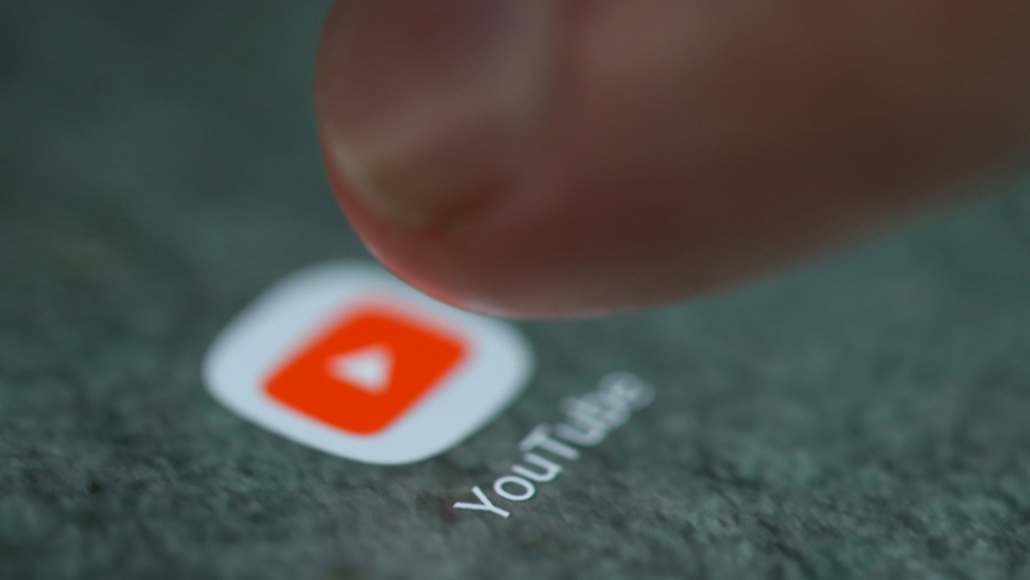 The YouTube app logo is seen on a smartphone in this picture illustration. YouTube, owned by Google, is the world's largest video site.