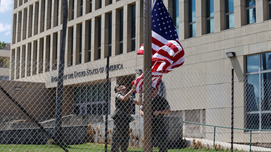 US Marines raise the American flag at half-staff at the US Embassy in Havana, Cuba, on Oct. 2, 2017.
