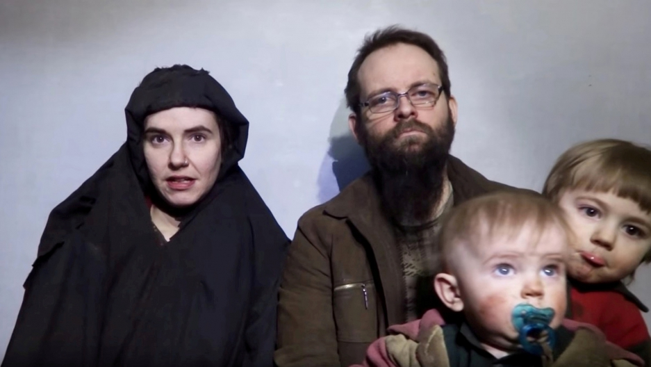 A still image from a video posted by the Taliban on social media on Dec. 19, 2016, shows American Caitlan Coleman, left, speaking next to her Canadian husband Joshua Boyle and their sons.