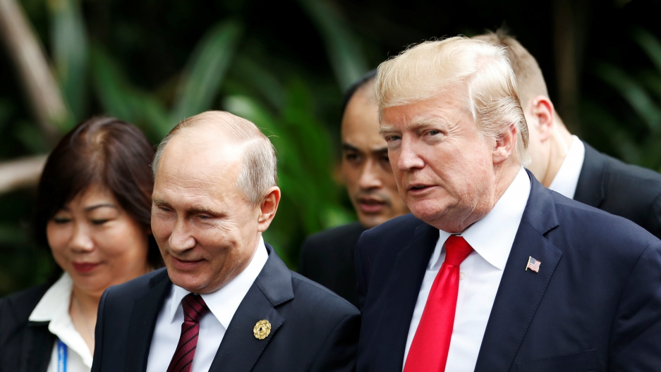 US President Donald Trump and Russian President Vladimir Putin attend the family photo session at the APEC Summit in Danang, Vietnam, Nov. 11, 2017.