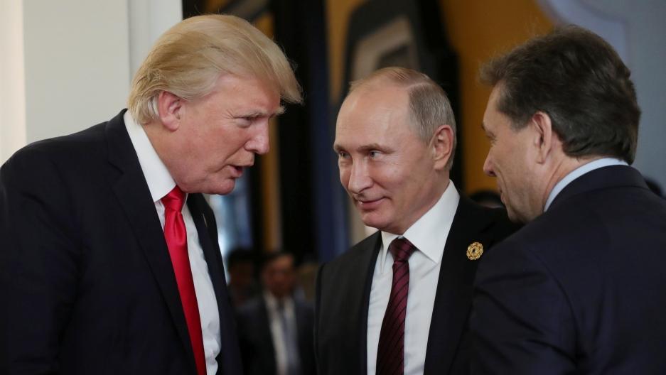 US President Donald Trump and Russian President Vladimir Putin talk