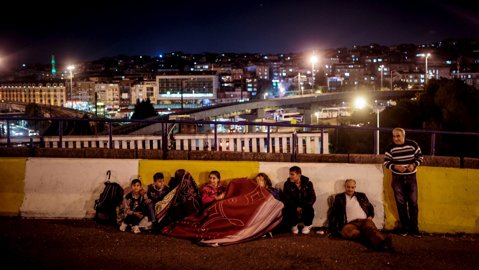A migrant family spends the night near the main bus station in Istanbul on Sept. 17, 2015.