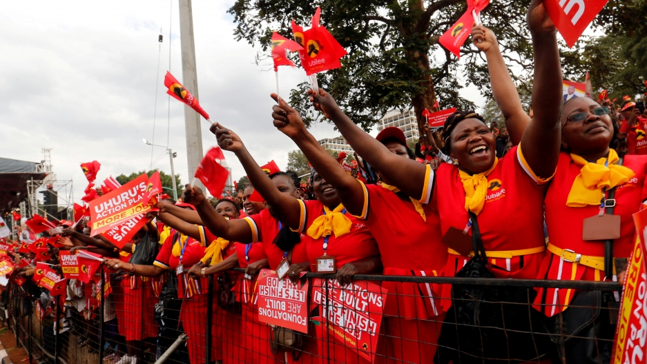 Supporters of Kenya's President Uhuru Kenyatta cheer during a Jubilee Party campaign rally at Uhuru park in Nairobi, Kenya August 4, 2017.