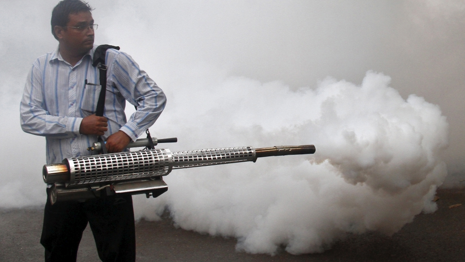A health worker fumigates a residential area to prevent the spread of dengue fever in Chandigarh, India, September 20, 2015.