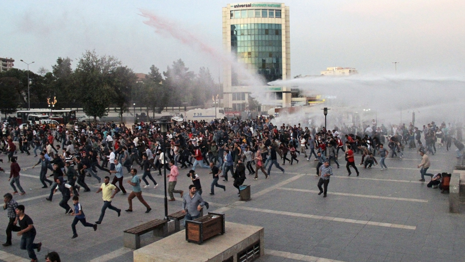 Police in Diyarbakir, Turkey, on October 11, 2015 use tear gas and water cannon to disperse people marching to protest the double suicide bombing in Ankara that killed up to 128 people.