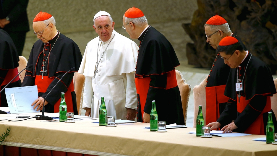 Pope Francis arrives to lead a special audience to mark 50th anniversary of Synod of Bishops in Paul VI hall at the Vatican on October 17, 2015.