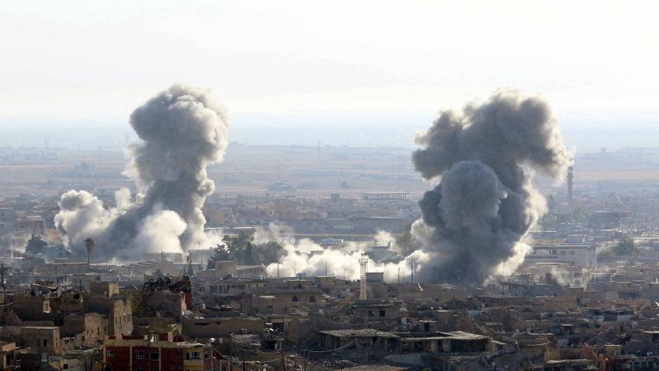 Smoke rises from the site of U.S.-led air strikes in the town of Sinjar, Iraq November 13, 2015.