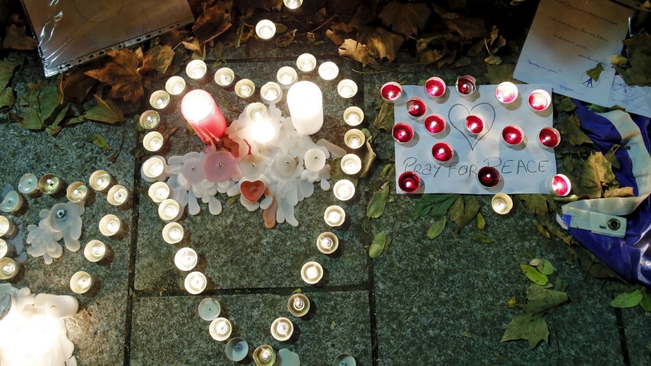 Candles burn as a tribute to victims near the site of the attack at the Bataclan concert hall in Paris in November, 2015.