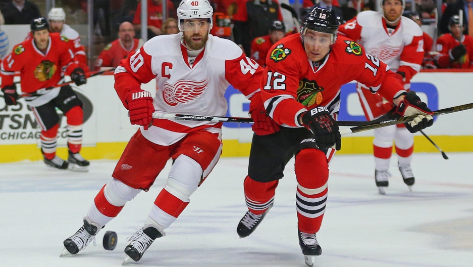 Two hockey players battling on ice
