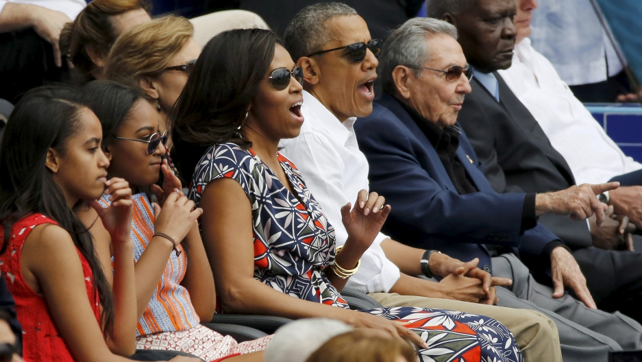 President Barack Obama and his family with Cuban President Raul Castro at an exhibition baseball game between the Cuban National team and the MLB Tampa Bay Rays in Havana.