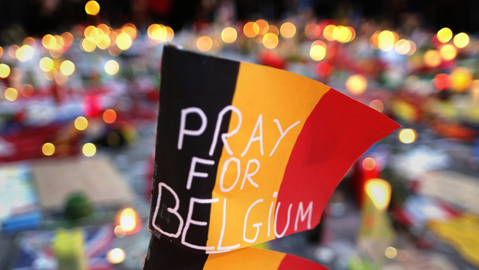 Belgian flags seen at a street memorial service near the old stock exchange in Brussels following Tuesday's bomb attacks