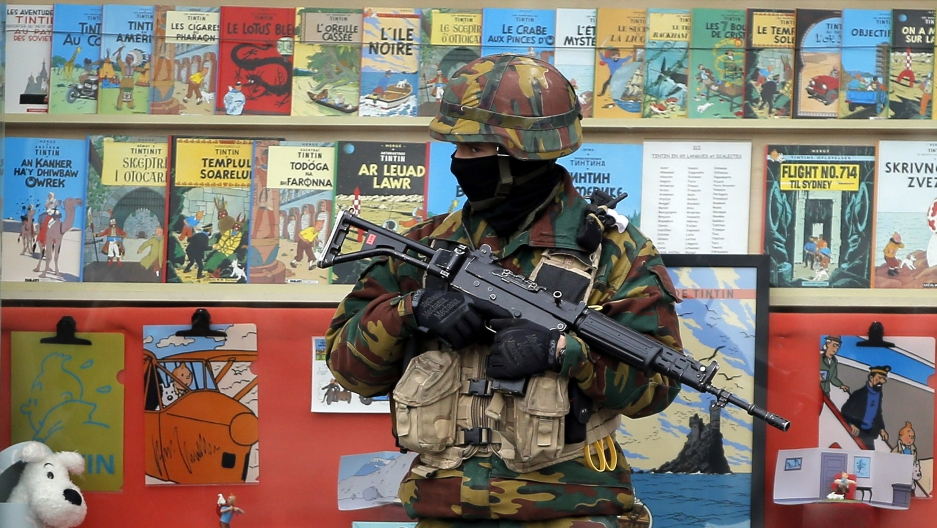 A Belgian soldier stands guard in front of a book store in central Brussels