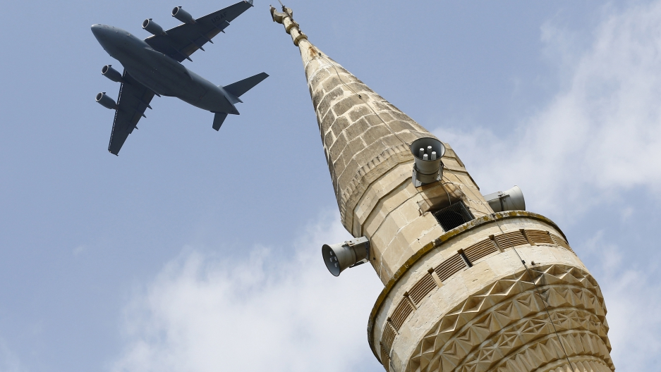 A US Air Force transport aircraft flies over a minaret after taking off from Incirlik air base in Adana, Turkey, in August 2015. After the attempted coup, operations at the air base were halted.