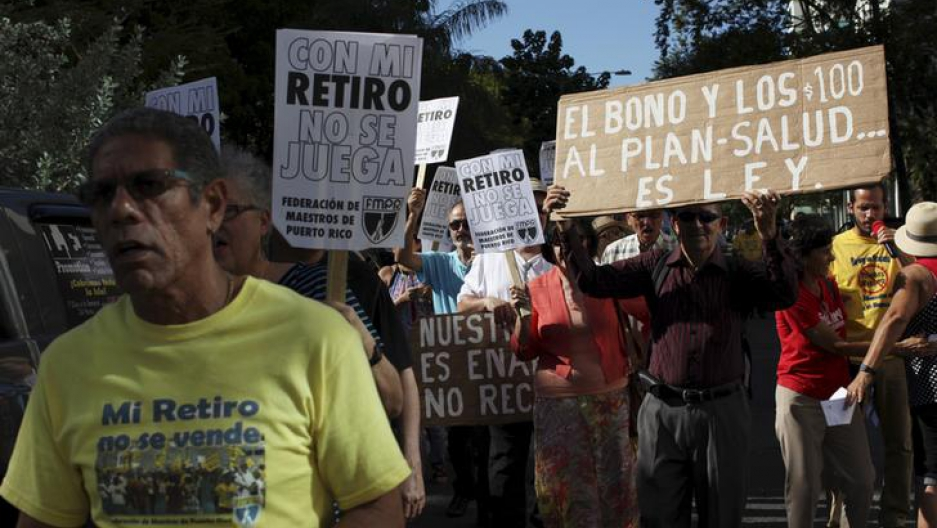 "Retired teachers from Puerto Rico's Teachers Federation protest against the underfunding of their pension system in San Juan, March 18, 2016. The sign reads ""Don't play with my retirement."""