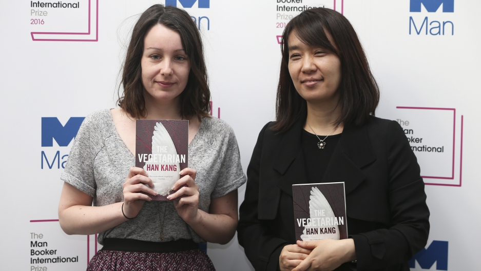 "Nominated translator Deborah Smith (L) and author Han Kang pose with their novel ""The Vegetarian"", during a media event for the Man Booker International Prize 2016, in London, Britain May 15, 2016."