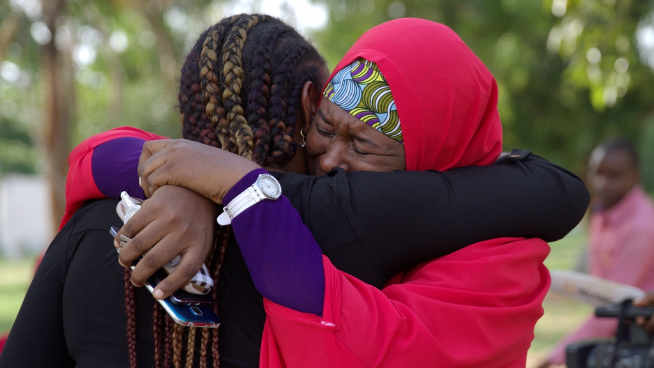 Members of the #BringBackOurGirls (#BBOG) campaign embrace each other at a sit-out in Abuja, Nigeria May 18, 2016.