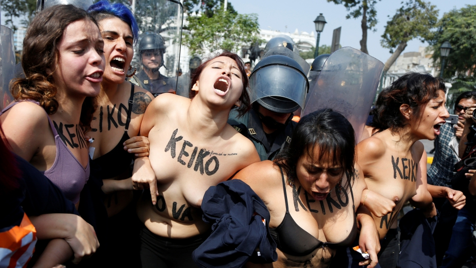 "Activists seeking to legalize abortion protest against Peruvian presidential candidate Keiko Fujimori in front of the Congress in Lima, Peru, May 19, 2016. The text on the activists read: ""No Keiko."""