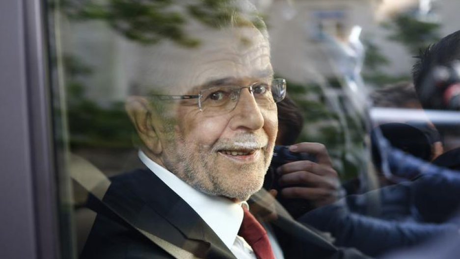 Left-wing independent candidate Alexander Van der Bellen smiles out of the window of a car after winning Austrian presidential election in Vienna, Austria,