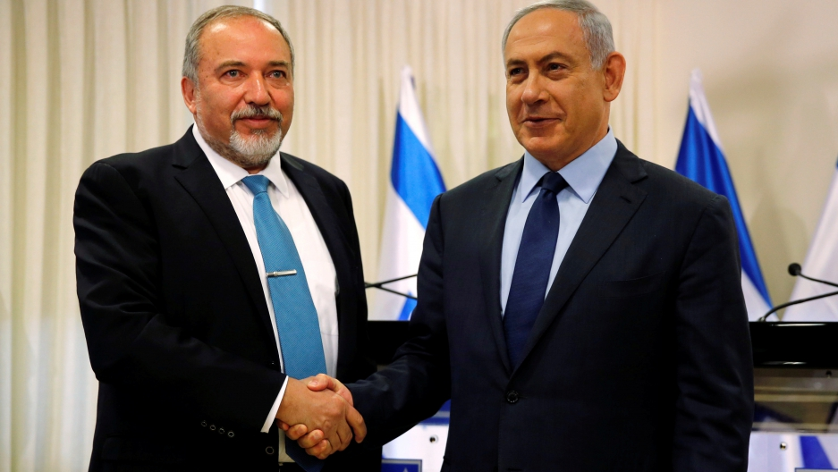 Avigdor Lieberman (L) and Israeli Prime Minister, Benjamin Netanyahu, after agreeing a new coalition deal last week, which gave Lieberman the Defense Ministry