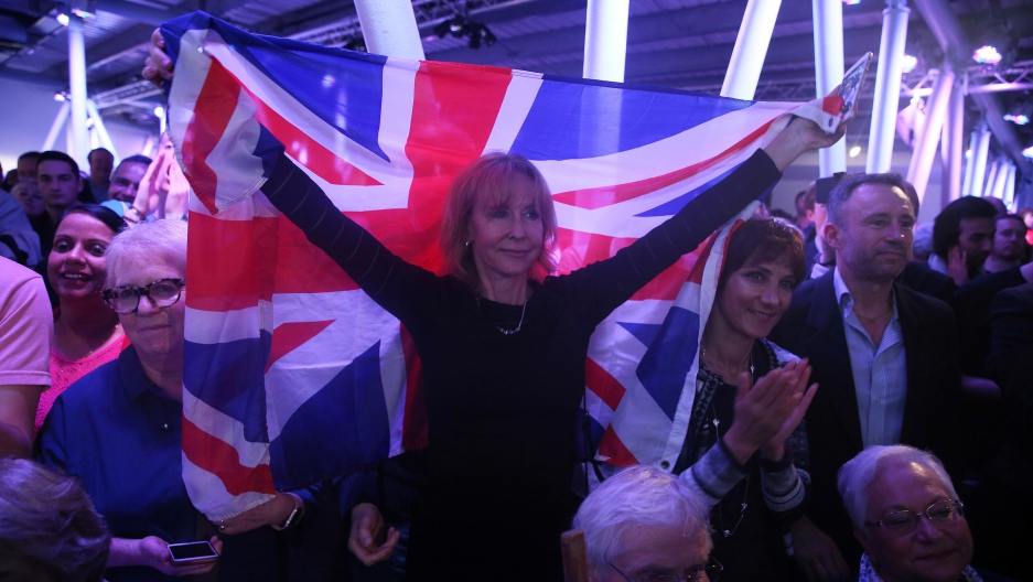 A Brexit supporter holds a Union Flag at a 'Vote Leave' rally in London