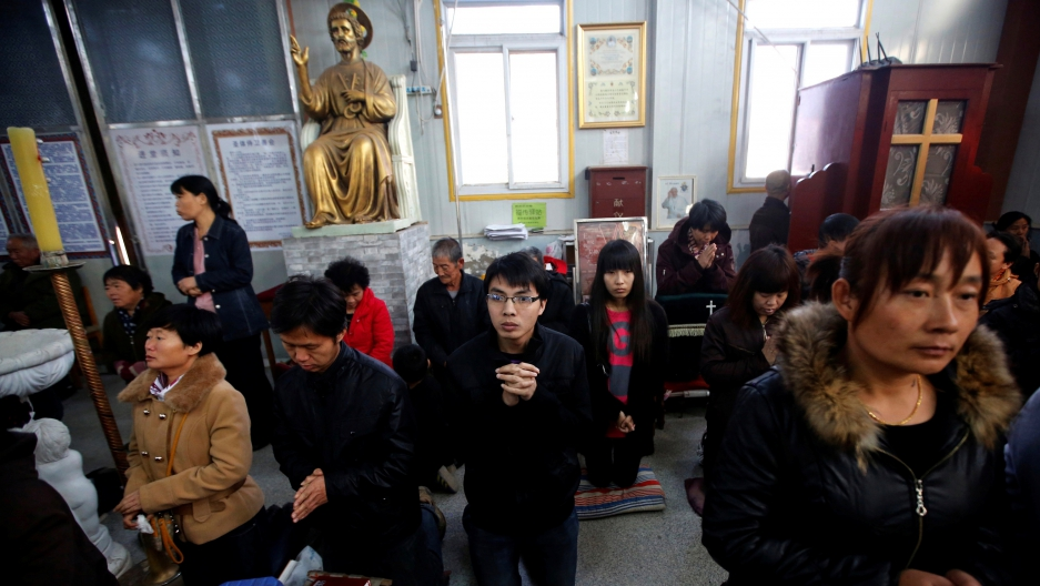 Chinese believers take part in a weekend liturgy at an underground Catholic church in the city of Tianjin on Nov. 10, 2013.