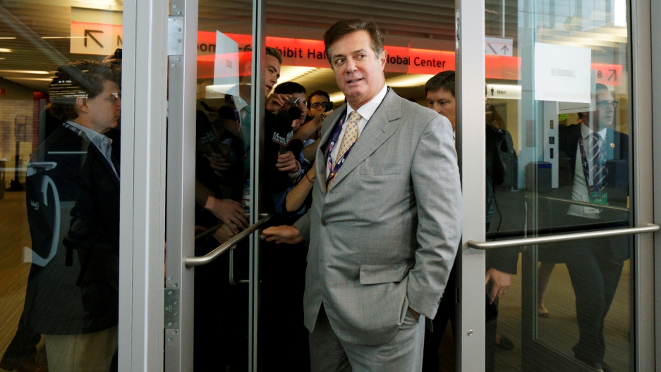 Paul Manafort, then-campaign manager to Donald Trump, escaping a mob of reporters in Cleveland, Ohio, on July 14, 2016.