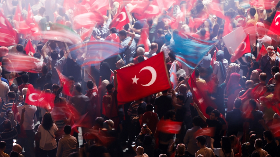 Supporters of Turkish President Tayyip Erdogan wave Turkish national flags during a pro-government demonstration on Taksim square in Istanbul, Turkey, July 19, 2016.