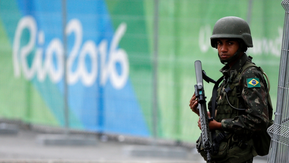 A Brazilian soldier stands guard outside the 2016 Rio Olympics Park in Rio de Janeiro, Brazil, on July 21.