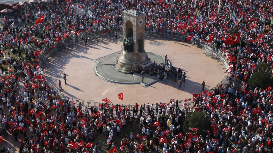 Supporters of various Turkish political parties gather in Istanbul's Taksim Square on July 24.