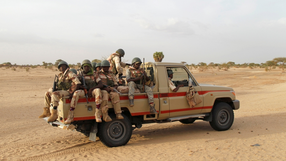 Nigerien soldiers patrol at the border with neighbouring Nigeria near the town of Diffa.