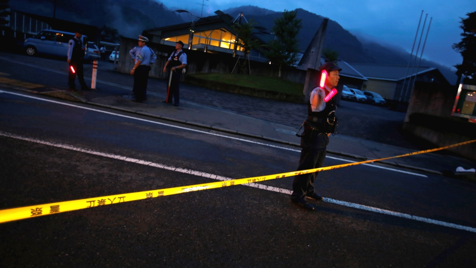 Police officers guard the front of a center for the disabled, where a mass knife killing took place, in Sagamihara, Kanagawa prefecture, Japan, on July 26.
