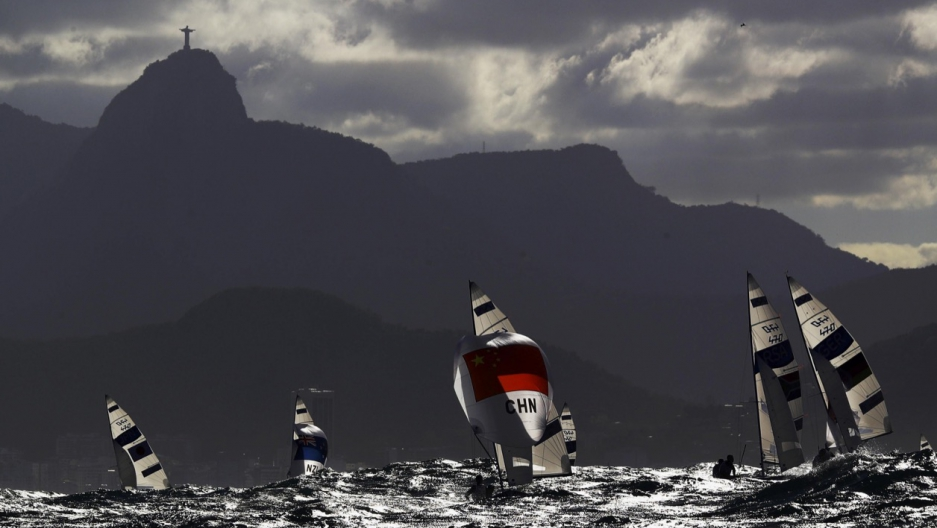 Sailors compete under the Christ the Redeemer statue at the 2016 Rio Olympics.