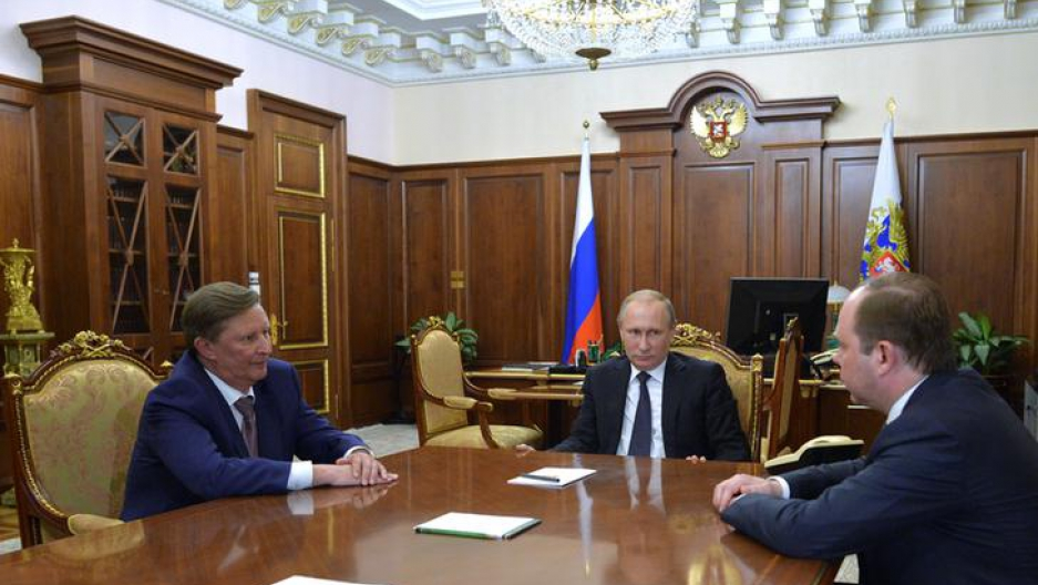 Russian President Vladimir Putin (C) meets with his special envoy on environment and transport Sergei Ivanov (L) and newly appointed chief of staff Anton Vaino at the Kremlin