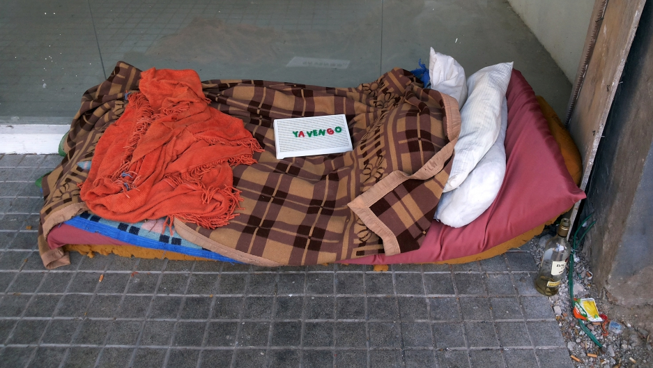 "A make-shift bed of a homeless person, with a sign on top that reads ""I'll be right back,"" in Buenos Aires, Argentina, on Sept. 11."