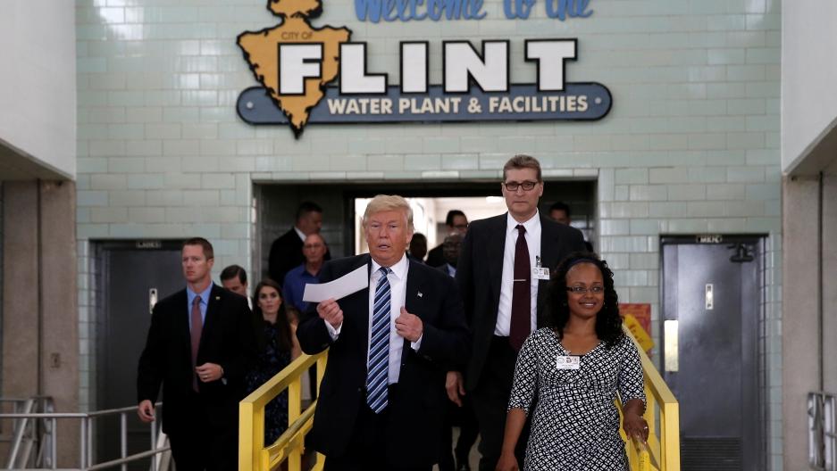 The President walks down a hallway