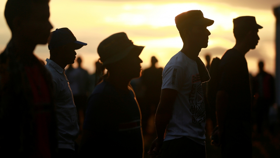Fighters from Revolutionary Armed Forces of Colombia (FARC),stand in line during the opening of ceremony congress at the camp where they prepare for ratifying a peace deal with the government, near El Diamante in Yari Plains, Colombia, September 17, 2016.
