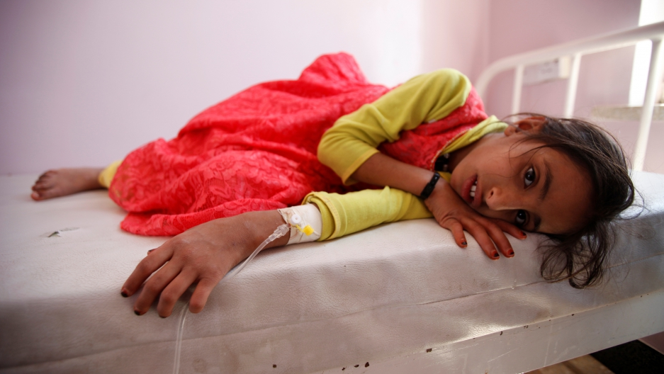 A child with cholera lays silently on a hospital gurney in Sanaa, Yemen in October 2016, The May 2017 outbreak is more widespread.