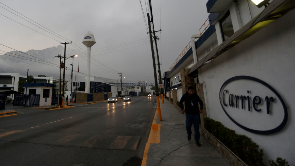 A worker walks past the Carrier plant in Santa Catarina, on the outskirts of Monterrey, Mexico. One of Trump's campaign promises was to prevent further Indiana-based Carrier jobs from moving to Mexico.