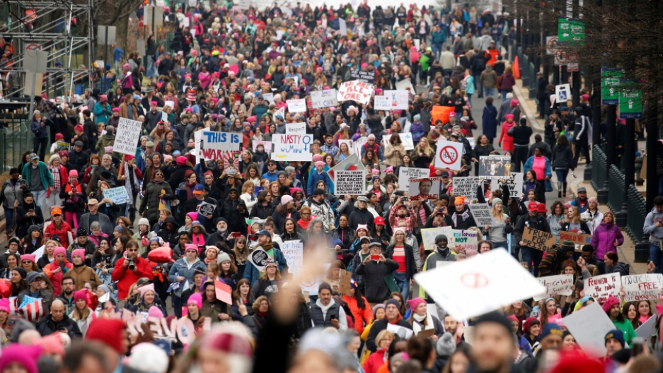 A crowd of people marching in Washington DC