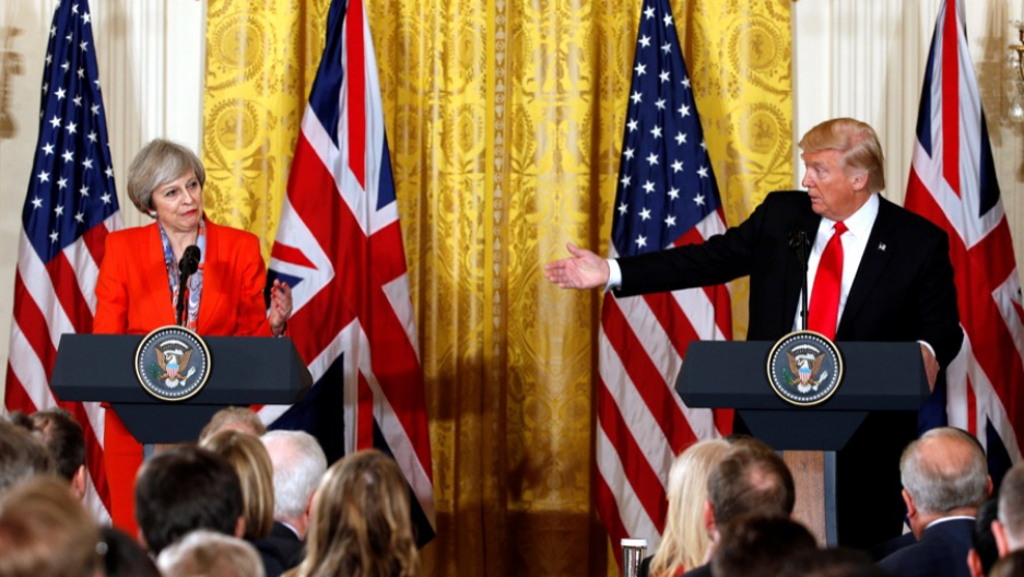 British Prime Minister Theresa May listens as US President Donald Trump speaks during their joint news conference at the White House in Washington, on Jan. 27.