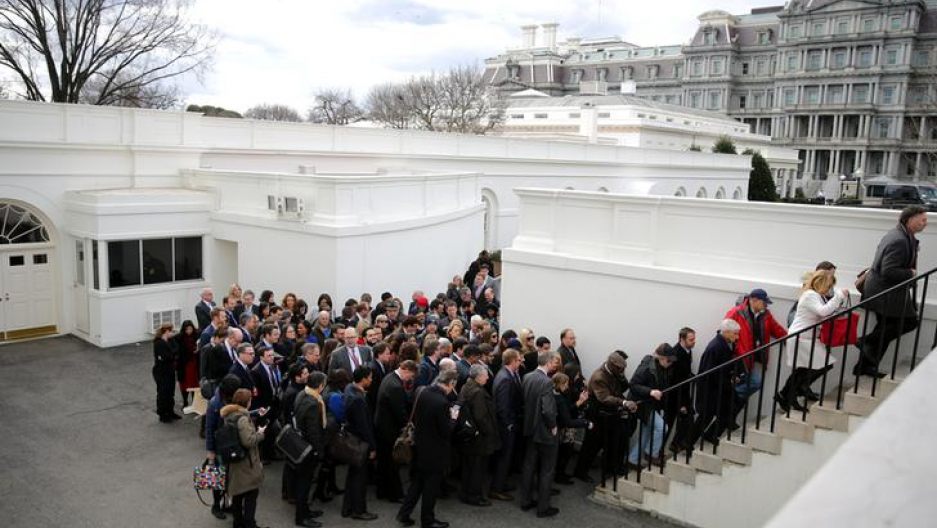 Members of the media line up to attend a news conference between British Prime Minister Theresa May and U.S. President Donald Trump at the White House in Washington, DC, U.S.