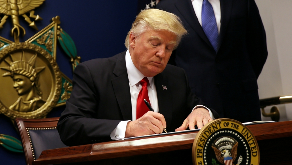 US President Donald Trump signs an executive order restricting immigration and refugee resettlement, at the Pentagon in Washington, DC, Jan. 27, 2017. Federal courts later blocked the order. Picture taken January 27, 2017.