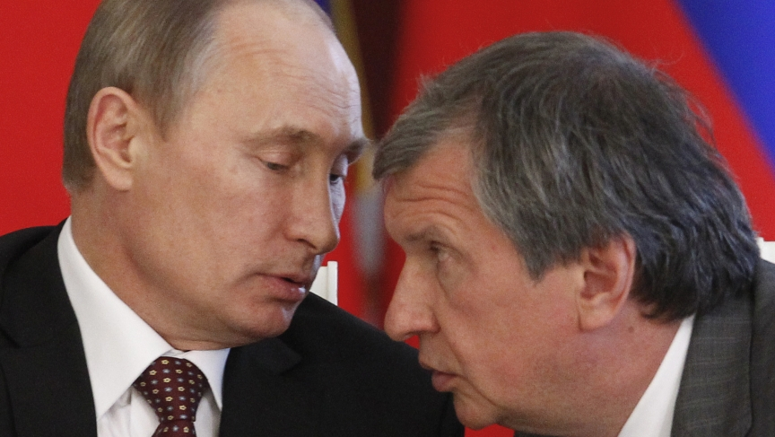 Russian President Vladimir Putin talks to Rosneft President and close adviser Igor Sechin.  Sechin is said to be the second most powerful man in Russia.
