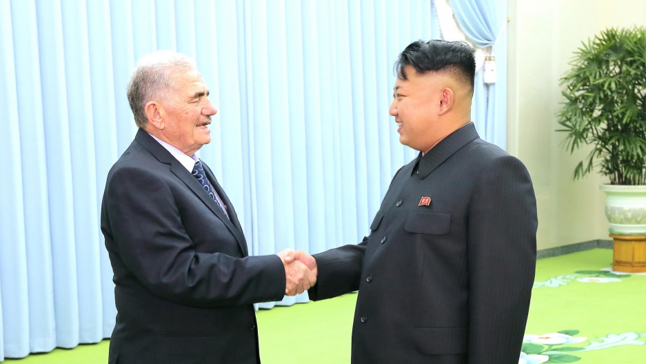 North Korean leader Kim Jong-un (R) meeting Abdullah al-Ahmar, deputy general secretary of Syria's ruling Baath Party, on a visit to Pyongyang in 2013
