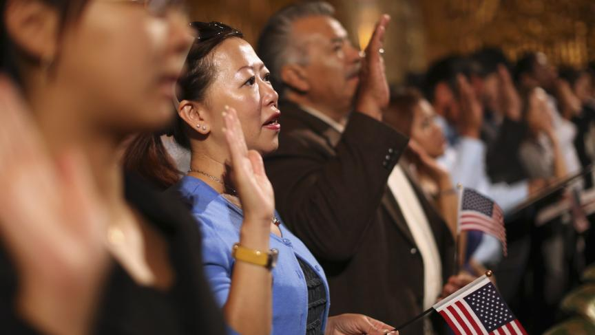 New citizens are naturalized during a ceremony in Oakland, California, on August 13, 2013.